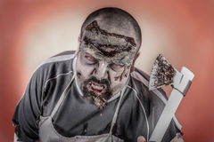 Butcher zombie. Is a man dressed zombie one with butcher knives and axes Stock Photography