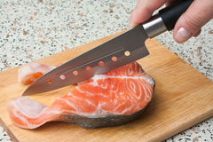 Butchering of salmon Royalty Free Stock Photos