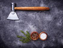 Butchers axe for meat and spices. Kitchen background. Top view Royalty Free Stock Photo