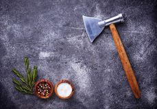 Butchers axe for meat and spices. Kitchen background. Top view Royalty Free Stock Images
