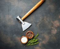 Butchers axe for meat and spices. Kitchen background. Top view Stock Photo