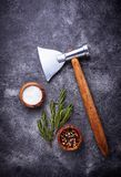 Butchers axe for meat and spices. Kitchen background. Top view Royalty Free Stock Image