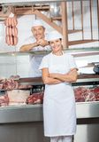 Butchers At Display Counter In Butchery Royalty Free Stock Image
