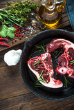 Butchers fresh lamb chops on frying pan Royalty Free Stock Images