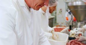 Butchers preparing sausage. At butcher shop stock video footage