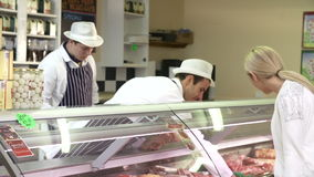 Butchers Serving Customers In Shop stock video