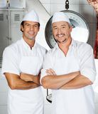 Butchers Standing Arms Crossed In Butchery Stock Photography