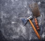 Butchers vintage cleaver and axe for meat. Top view Royalty Free Stock Images