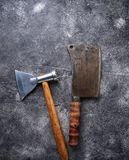 Butchers vintage cleaver and axe for meat. Top view Royalty Free Stock Photo
