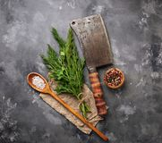 Butchers vintage cleaver with spices. Top view Stock Images