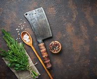 Butchers vintage cleaver with spices. Top view Royalty Free Stock Images