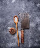 Butchers vintage cleaver with spices. Top view Stock Image