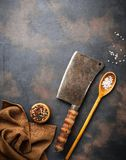 Butchers vintage cleaver with spices. Top view Royalty Free Stock Photo