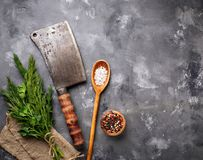 Butchers vintage cleaver with spices. Top view Stock Photos