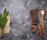 Butchers vintage cleaver with spices. Top view Royalty Free Stock Image