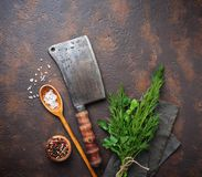 Butchers vintage cleaver with spices. Top view Royalty Free Stock Photography