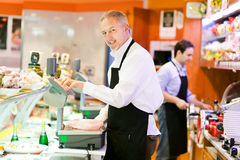 Butchers at work Royalty Free Stock Photo