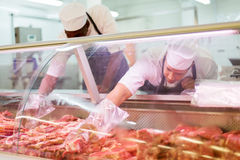 Butchers working butchery Stock Image