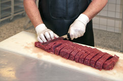 Butchers workstation. Male butcher working at his station Stock Images