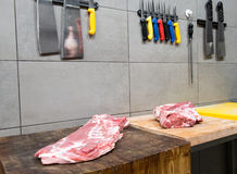 Butchery with meat and knives Royalty Free Stock Images