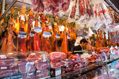Butchery shop in La Boqueria market. BARCELONA - AUGUST 24: Unidentified man works in butchery shop in La Boqueria market on August 24, 2010 in Barcelona. One of Royalty Free Stock Photos