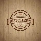 Butchery vintage logo. Fresh meat market. Embossed logo on vintage wooden background. Steak house sign stock illustration