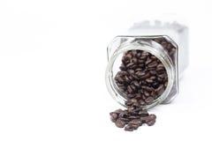 Butelek kawowych fasoli kubek Fotografia Stock