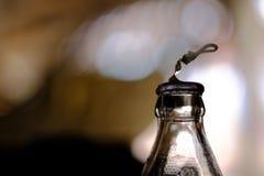 Butelek nakrętki z bokeh Obrazy Royalty Free