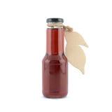 Butelka czerwony ciecz Zdjęcia Stock