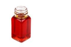 Butelka różany biodro olej na białym tle Obrazy Stock