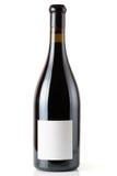 Butelka Shiraz czerwone wino na bielu zdjęcia royalty free