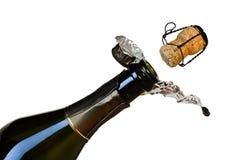 Butelka szampan i odjeżdżanie korek odizolowywający na białym tle zdjęcia stock