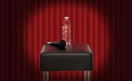 Butelka woda obok mikrofonu Obrazy Royalty Free