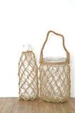 Butelka z rybak siecią Fotografia Stock