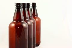 butelki brąz cztery Obrazy Royalty Free