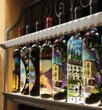 Butelki dekorować z pięknymi krajobrazami Bellagio Zdjęcie Royalty Free