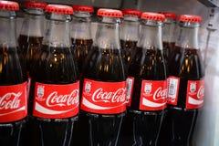 Butelki koka-kola sławny napój w fridge Obrazy Royalty Free