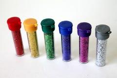 Butelki kolorowa błyskotliwość na białym tle odizolowywającym Obraz Royalty Free