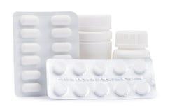 Butelki medycyny i pigułki w bąbel paczce Obrazy Stock