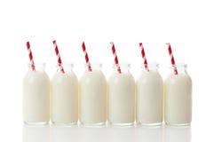 butelki mleka rząd Obrazy Stock