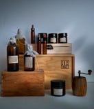 Butelki na półce w starej aptece Obrazy Royalty Free
