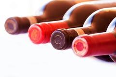 Butelki Odizolowywać czerwone wino Zdjęcia Royalty Free
