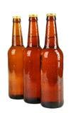 Butelki piwo z kroplami odizolowywać na bielu Fotografia Royalty Free