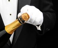 butelki szampański otwarcia kelner zdjęcia stock