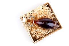 Butelki wino lub ziołowy syrop, Obrazy Stock