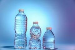 butelki woda trzy Fotografia Royalty Free