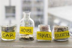 Butelki z pieniądze i monetami obrazy royalty free