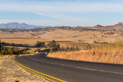 Butha-Buthe Suburbs, Lesotho. A road leads into the countryside in the Leribe district of the mountainous South African country, Lesotho royalty free stock images