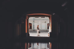 Butiful blonde woman in the end of tunnel royalty free stock photography