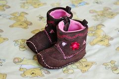 Butins de bébé de Brown Photos libres de droits